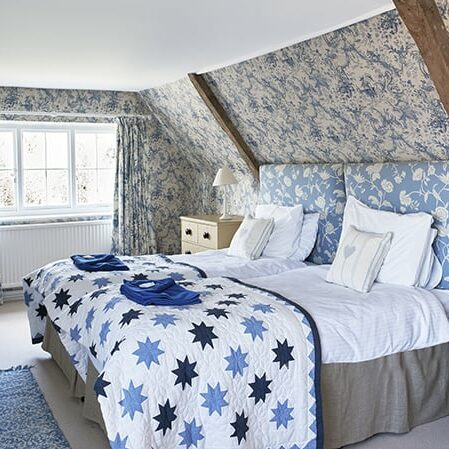 Blue bedroom with twin beds for website