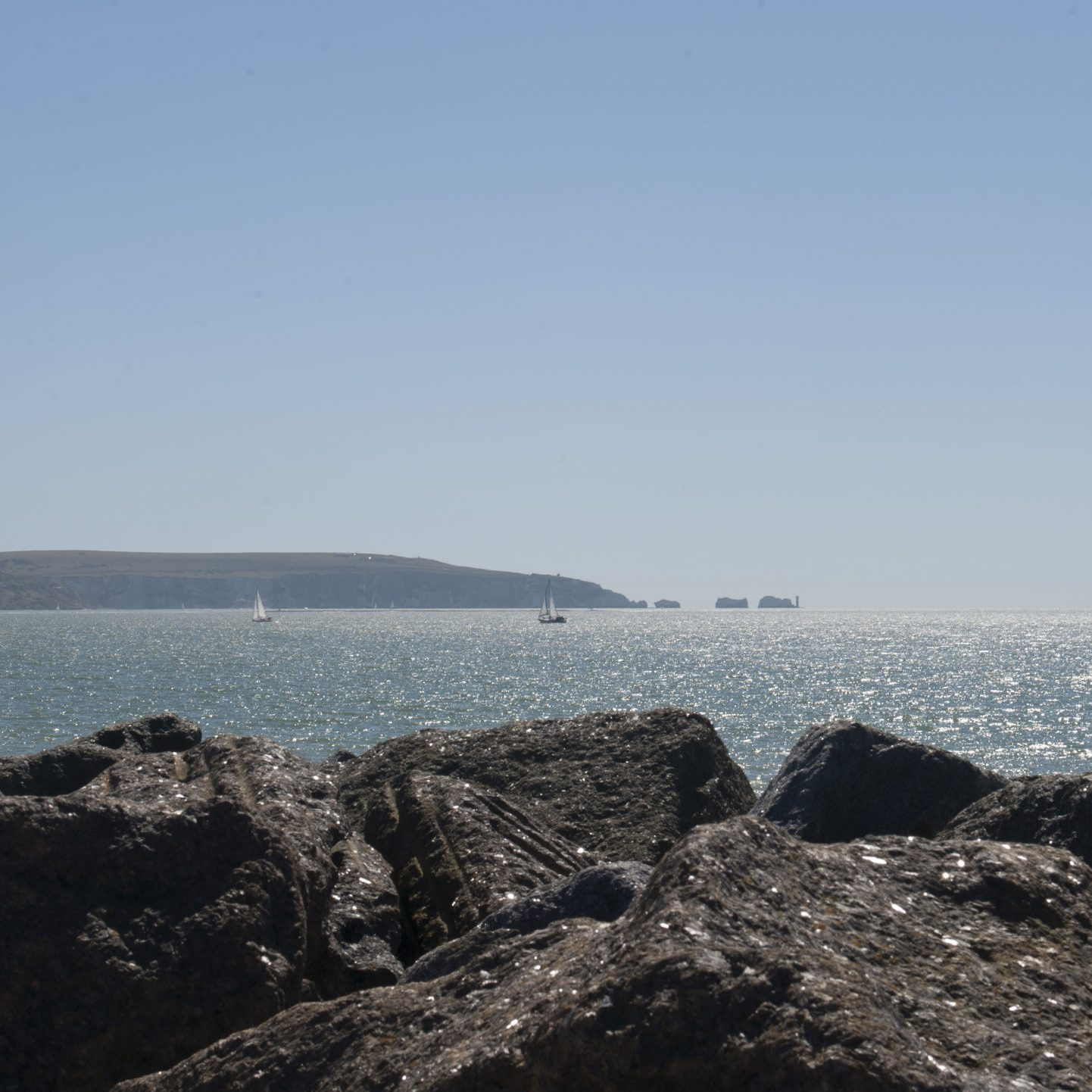 New Forest Bus Route From Milford beach, looking towards Hurst Spit, then the Isle of Wight, showing the Needles